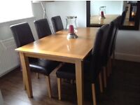 MORRIS FURNITURE OAK DINING TABLE AND 6 BROWN LEATHER CHAIRS GOOD CONDITION £130 ONO