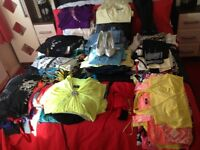 150 items of ladies clothes , jeans , shorts , evening tops ,beach wear , sizes 12/14