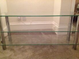Chrome/ clear glass tv and entertainment stand.