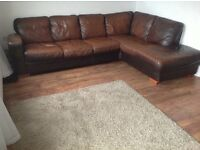 DFS brown leather corner sofa with footstool & cushion