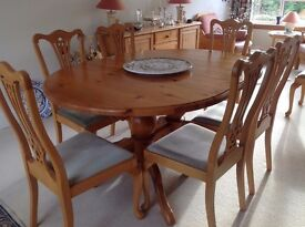 Dining room table with extra leaf and eight chairs