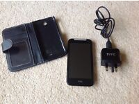 HTC mobile phone with case and charger