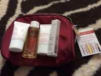 Clarins travel set 4 items plus a cosmetics bag
