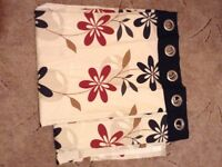 Pair of patterned, eyelet hole curtains