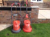 Flymow lawnmowers, one nearly new, both in good condition and working perfectly.
