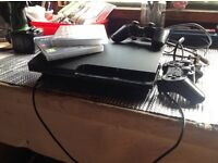 PS3 slim 250gig with two controllers all leads,microphone and camera and two games bargain at £55