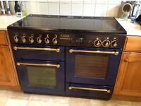 110CM,LEISURE GAS RANGE. BLUE/BLACK/BRASS TOTALLY IMMACULATE INSIDE AND OUT.