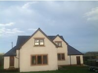 3 Bedroom modern, unfurnished detached house to let with garage, garden & sea views