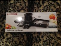 Brand New and Unused multi-purpose grater - collect from Guildford
