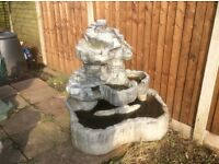 Concrete water feature with pump