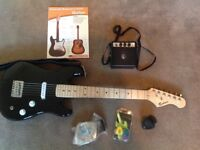 I/2 size electric guitar