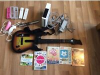 Wii console, controllers, guitar and games