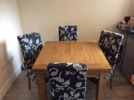 Oak dining table + Chairs (Oak furniture land, nearly new)