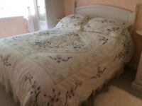 8 1/2 ft. Wide Bedspread and 2 pillow shams. Pale ivory base.