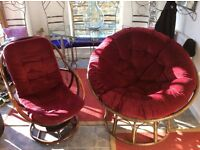 Two chairs with cane frames and wine coloured button cushions