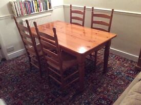 Pine dining table 150x85cm, small make on one chair seat, smoke and pet free home, good condition