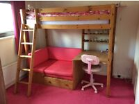 HIGHSLEEPER, SOLID PINE, WITH DESK, SHELVES AND PINK SOFA/SOFABED UNDERNEATH