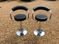 Bar Stools with adjustable height lever.