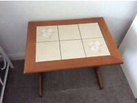 Nest of three tiled coffee tables