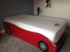 Single bed. Schumacher child car bed with pull out spare bed underneath. perfect for sleepovers!