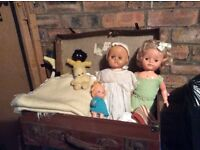 2 old dolls in case with some clothes