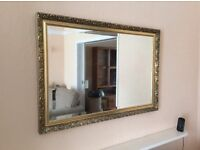 Large mirror in gold coloured wooden frame