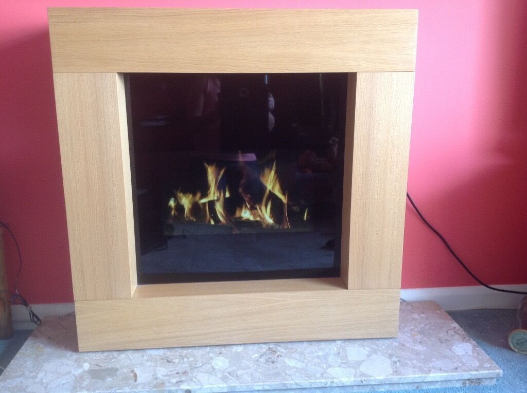 Electric fire with many viewing options like logs burning for Fish tank fireplace