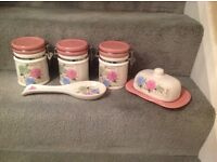 New tea,coffee,sugar canisters,butter dish & spoon rest.