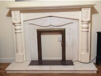 Fireplace with marble hearth and insert and wooden surround