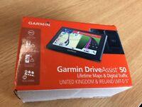 GARMIN DriveAssist 50. Combined sat nax and dash-cam. New & unused.