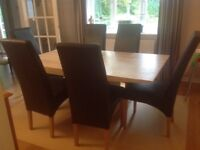 Monaco Travatine marble dining table and 6 dining room chairs.