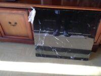 Black glass cooker splash back including bolts