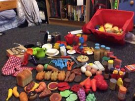 Large selection of play food, crockery, cutlery and pans.