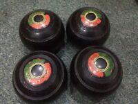 SET OF 4 BLACK BOWLING BALLS. BIBO A94 340