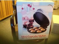 Mini cupcake maker. Great fun with children! Never been used.