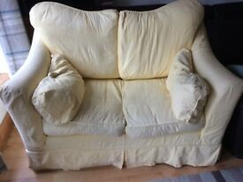 Yellow fabric two seater sofa