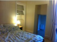 Large en suite double bedroom, suitable for single occupancy only, in comfortable family home.