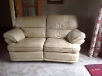 FREE - two seater cream leather recliner sofa.