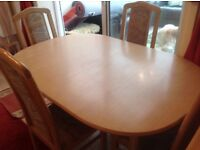 Excellent condition light wood extending table and 4 fabric and wood chairs