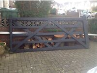 Large black wooden gate