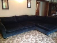 Dark blue corner Settee, with large footrest. Good condition- buyer to collect.