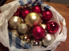 Christmas baubles, mainly gold, red and silver.