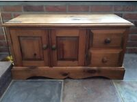 Pretty pine TV cabinet/ stand with 2 small side drawers and a cupboard underneath.