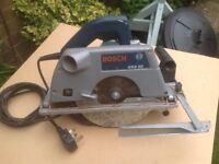 Bosch GKS65 Hand Held Circular Saw in good working order, together with fence guide.