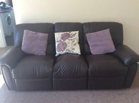 Reclining three seater leather sofa