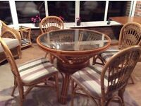 Glass top cane table newly upholstered chairs