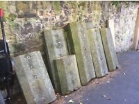 Various lengths of traditional cope stones originally from top garden wall