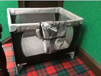 Hauck travel cot with carrier bag