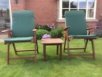 Set of two fold -up garden chairs with cushions and small table.