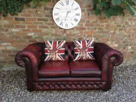 Oxblood 2 seater Chesterfield sofa. Can deliver